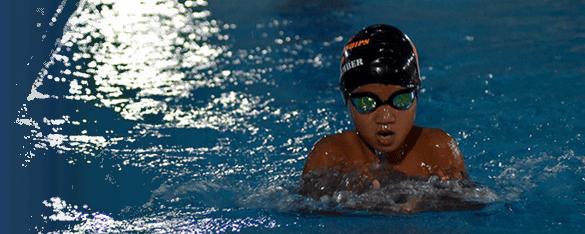 young boy at swim training in Bangkok