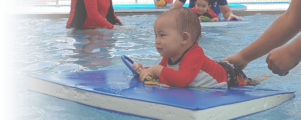 cute baby on a float in a swimming lesson in Bangkok