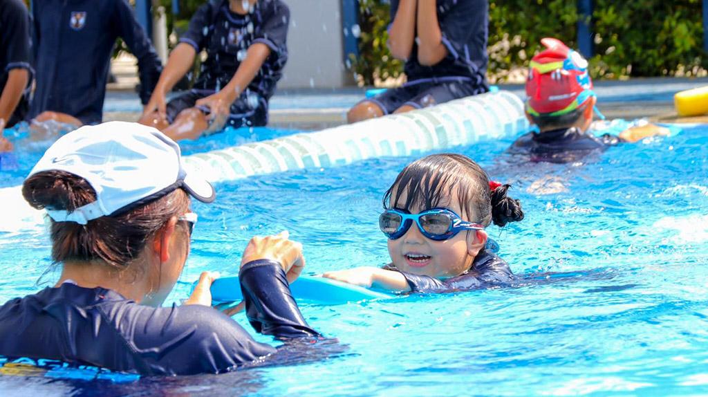 children having fun in a BEST learn to swim class, Bangkok